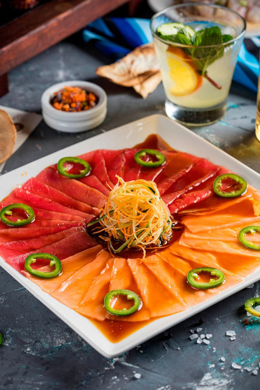 Sliced salmon and tuna marinated in oriental sauce,